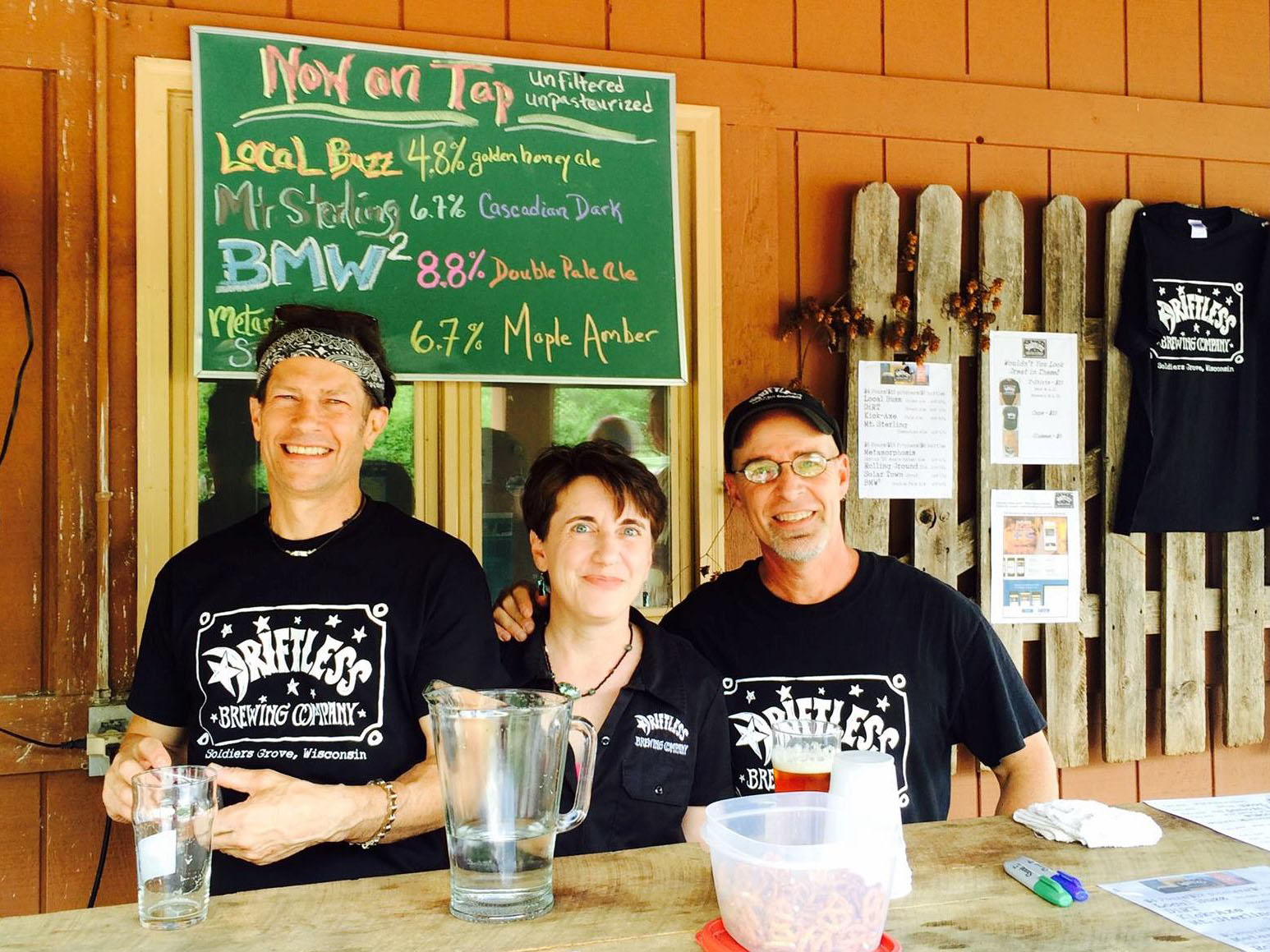 Chris, Cynthia & Michael serving beer at the Craft Beer Week Event.